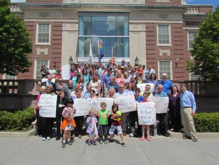 FUSN members celebrate the 10th anniversary of equal marriage on the Newton Court House steps. Photo: Eileen Kurkoski.